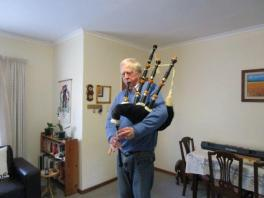 Neal playing the bagpipes